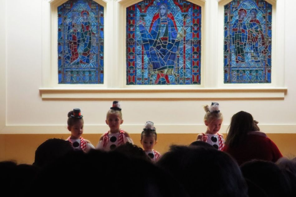 xmas feels. [Everything i feel about this holiday season in one shot. This was at my kid's christmas fundraiser show, and after these tiny dancers got used to the audience, they performed an excellent (& adorable) number!] Indoors  Real People Stained Glass Windows Holidays Christmastime Xmas Waiting Game Recital Dancers Childhood Children Dance Recital