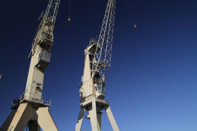 Blue Capital Cities  Construction Crane Crane Day Development Low Angle View Metallic No People Outdoors Sky Tall Tall - High Tourism Travel Destinations