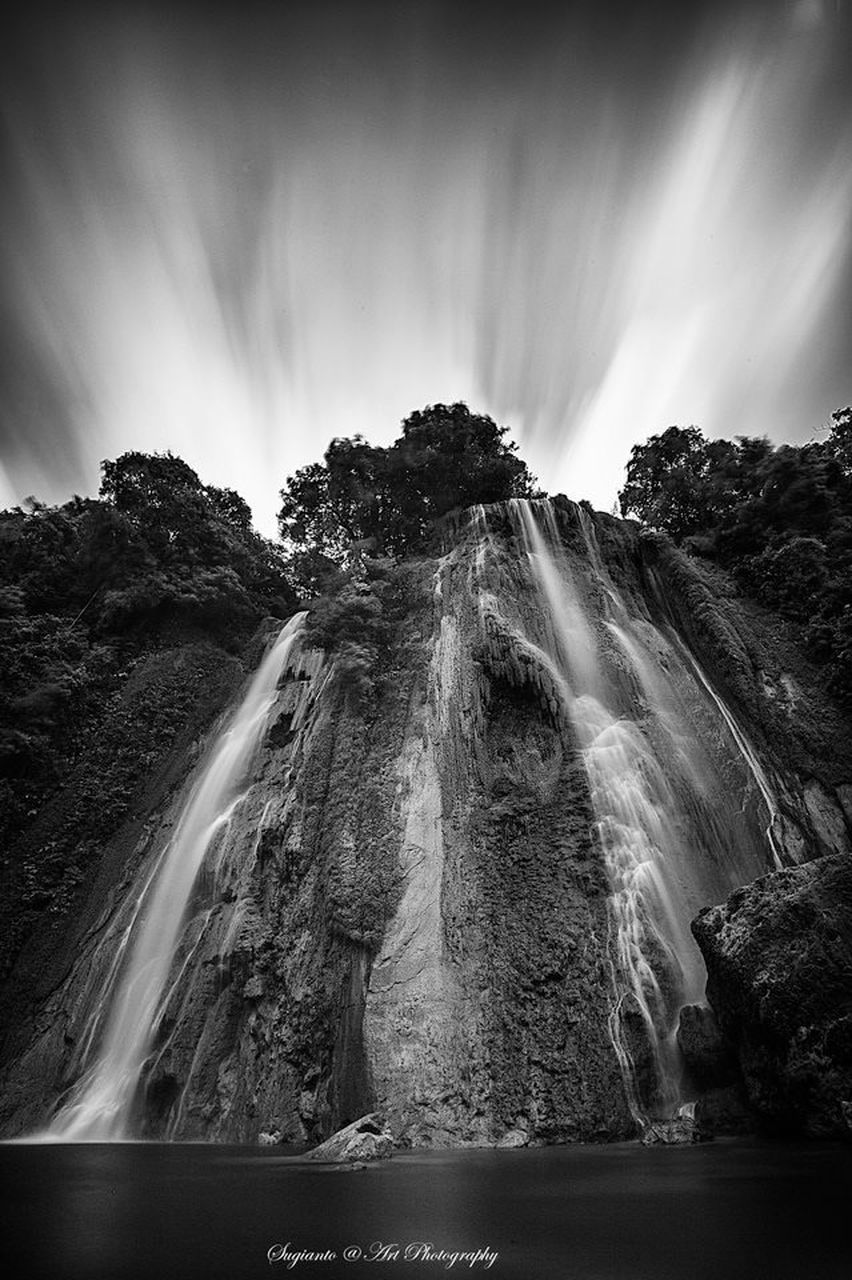 waterfall, long exposure, motion, water, scenics, nature, blurred motion, beauty in nature, tranquility, power in nature, tranquil scene, no people, travel destinations, day, outdoors, sky, landscape