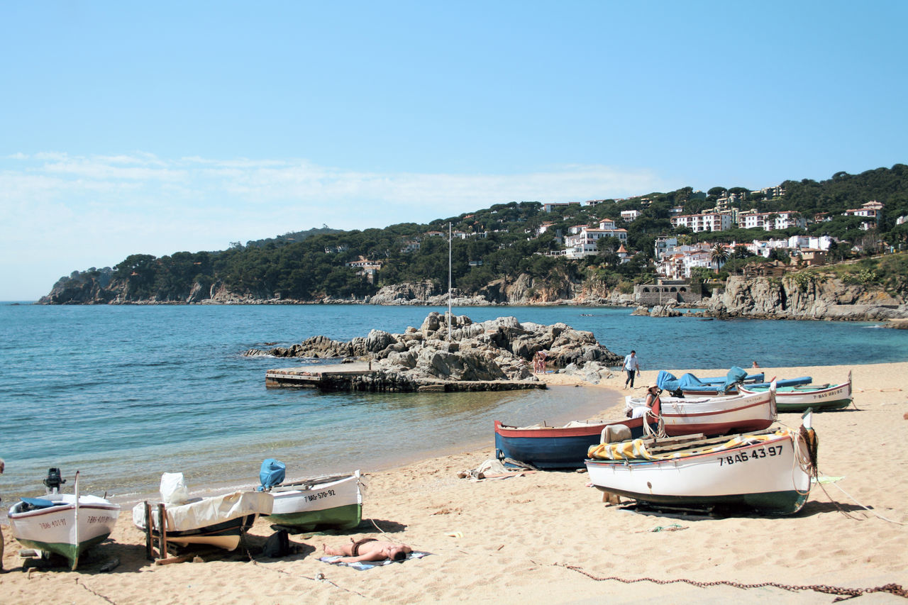 Calella de Palafrugell Architecture Beach Beauty In Nature Blue Building Exterior Clear Sky Day Live For The Story Mode Of Transport Moored Mountain Nature Nautical Vessel No People Outdoors Rock - Object Scenics Sea Sky Tranquility Transportation Tree Water