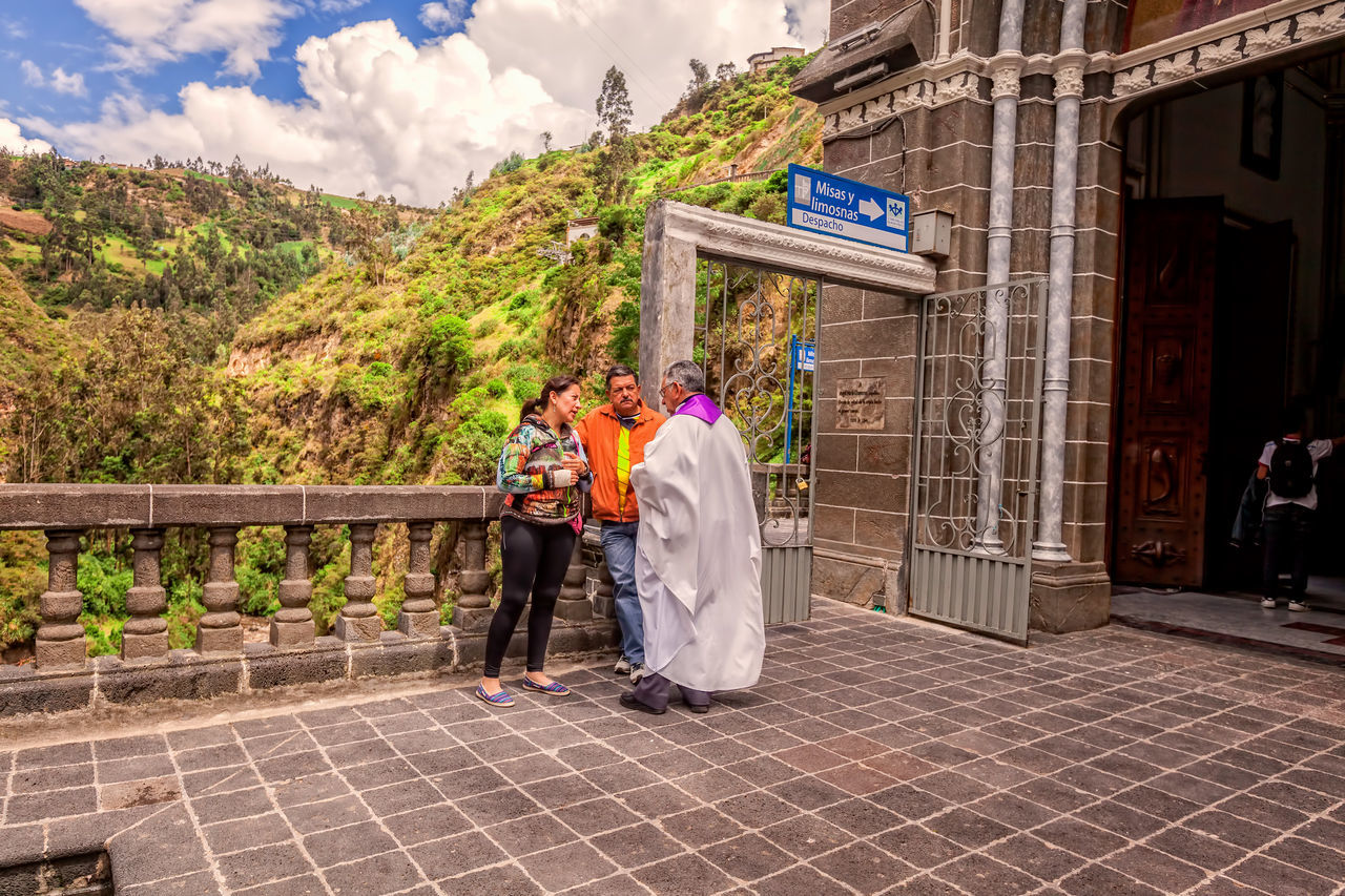 Ipiales, Colombia - 11 September 2016: Religious Couple Is Confessing To A Priest At Las Lajas Sanctuary A Basilica Church Located In The Southern Colombia, South America Adult Adults Only Andes Andes Mountains Architecture Arrival Business Finance And Industry Cathedral Catholic Catholic Church Church Colombia Confession Day Full Length Las Lajas Marble Mature Adult Mountain Outdoors People Priest Religious  South America Women