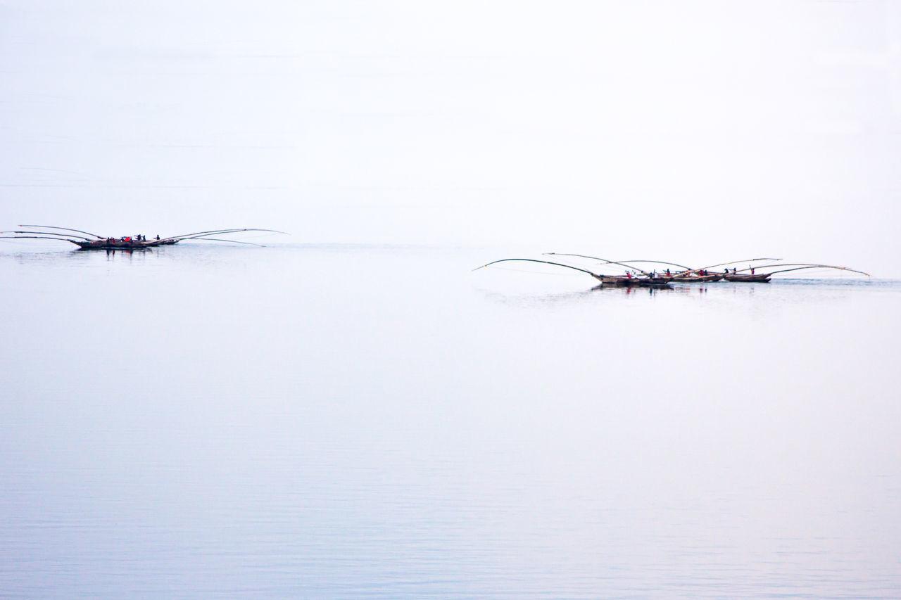 Rwandan Boatmen Rwandan Boatmen Africa Boats Rowing Fishing Boat Lake Kivu Traditional African Great Lakes Tri Hulled Boat Three Hulled Boat Lake Fishermen Rwanda Africa Let's Go. Together.