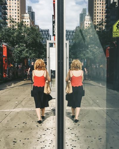 The woman in red NEM Submissions NEM VSCO Submissions I Heart New York AMPt - Street NEM Street Street Photography AMPt - Vanishing Point Reflection Reflection_collection Vanishing Point