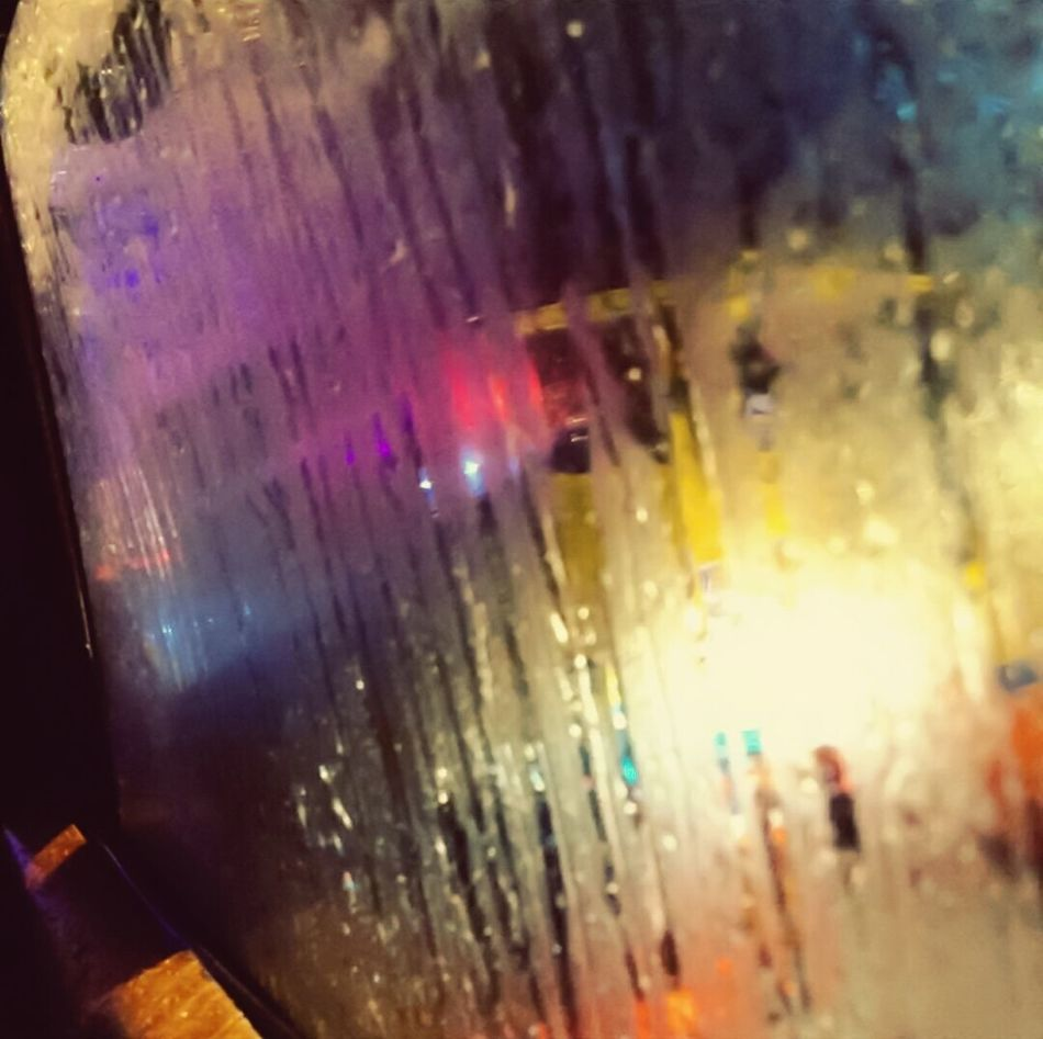 Into each life, some rain has got to fall... Multi Colored No People Close-up Indoors  Indoor Photography Reflections Lights In The City Lights Bumpercars Rainy Days Raindrops Window View Cars PassingBy