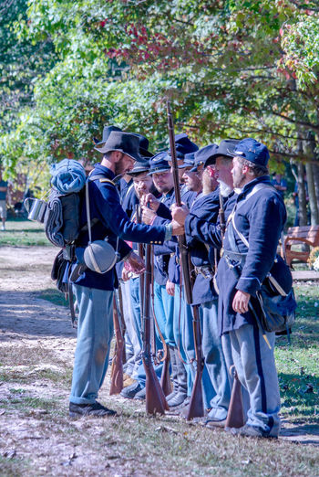 October 8, 4th Annual Mooresville Civil War Days , South Haven, Michigan; Union soldiers stand at the ready during a weopon check during this civil war reenactment Autumn Civil War Michigan Soldiers USA Uniforms Adult Costumes Day Fall Full Length Guns History Holding Men Military Outdoors Outdoors Photograpghy  People Reinactment Standing Togetherness Union Soldiers Weopon Check Young Men