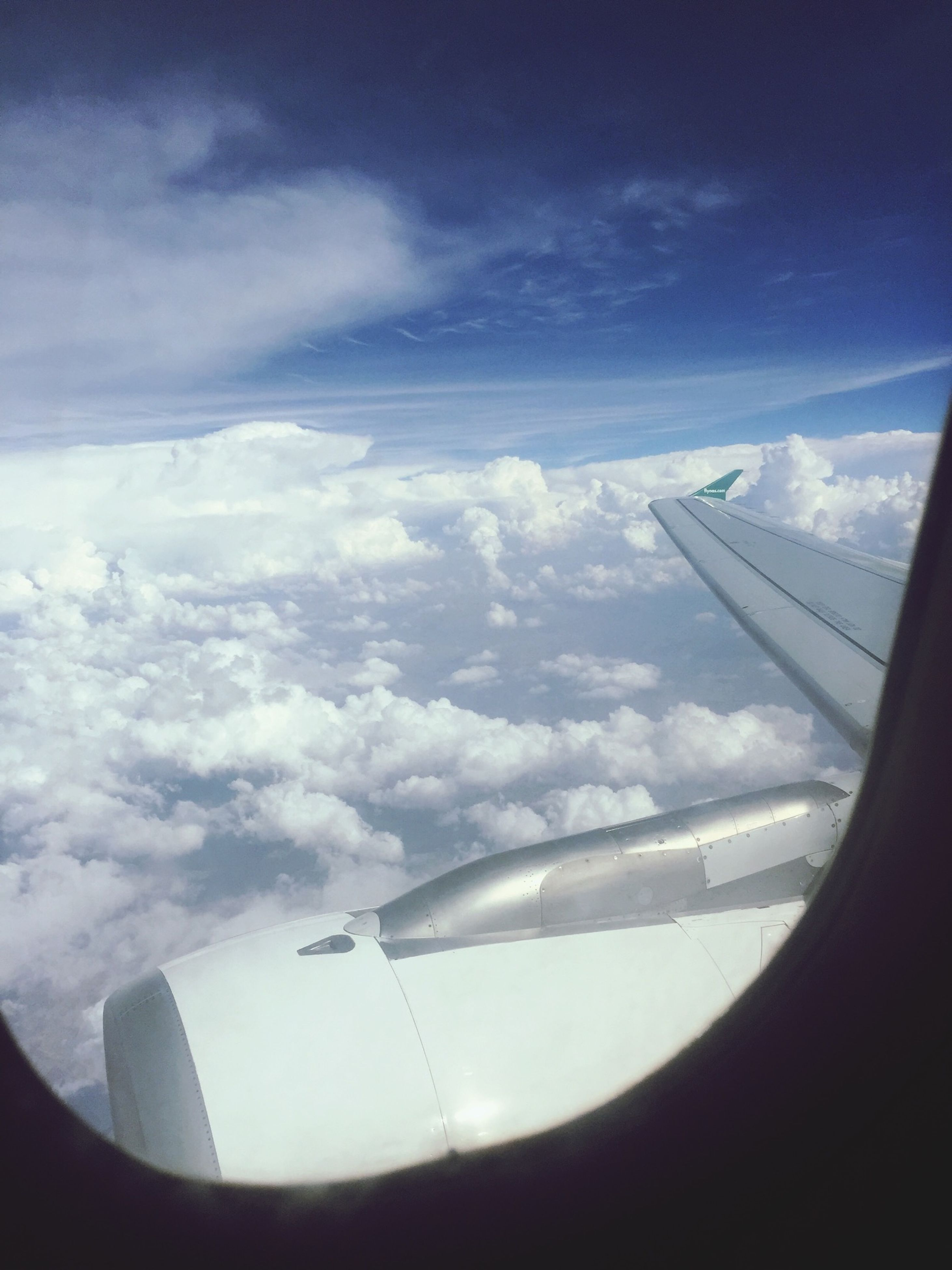 airplane, transportation, air vehicle, mode of transport, flying, aircraft wing, part of, mid-air, cropped, aerial view, on the move, travel, journey, sky, aeroplane, airplane wing, public transportation, aircraft, cloud - sky, vehicle part