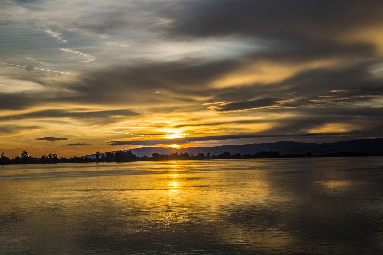 sunset, beauty in nature, tranquility, scenics, nature, sky, tranquil scene, reflection, water, cloud - sky, waterfront, no people, lake, silhouette, outdoors, mountain