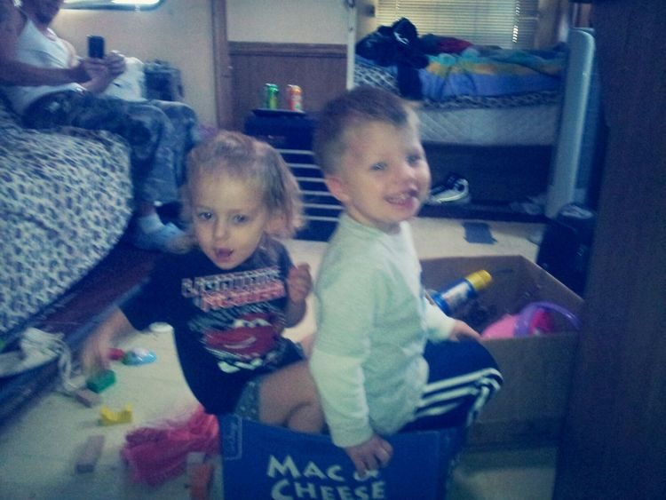 these two clever munchkins decided to sit on buckets inside the box so it would be like they were riding a motorcycle... <3
