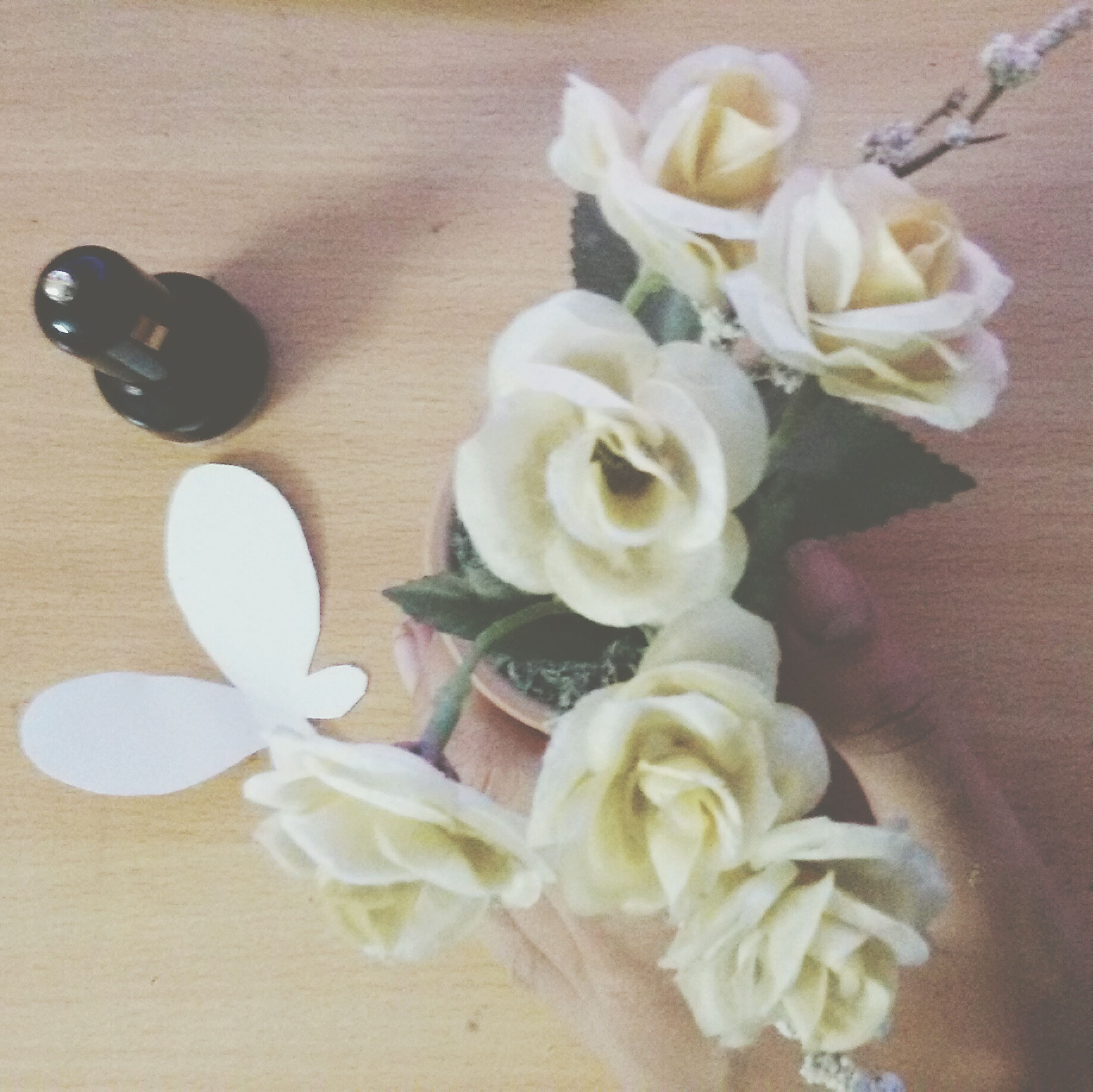 indoors, flower, table, high angle view, still life, freshness, vase, petal, close-up, white color, bouquet, fragility, decoration, rose - flower, flower head, directly above, variation, no people, home interior, flower arrangement
