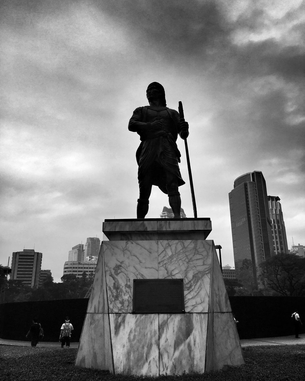 statue, sculpture, human representation, art and craft, male likeness, built structure, travel destinations, architecture, craft, monument, cloud - sky, sky, memorial, low angle view, outdoors, travel, city, building exterior, day, full length, shield, no people