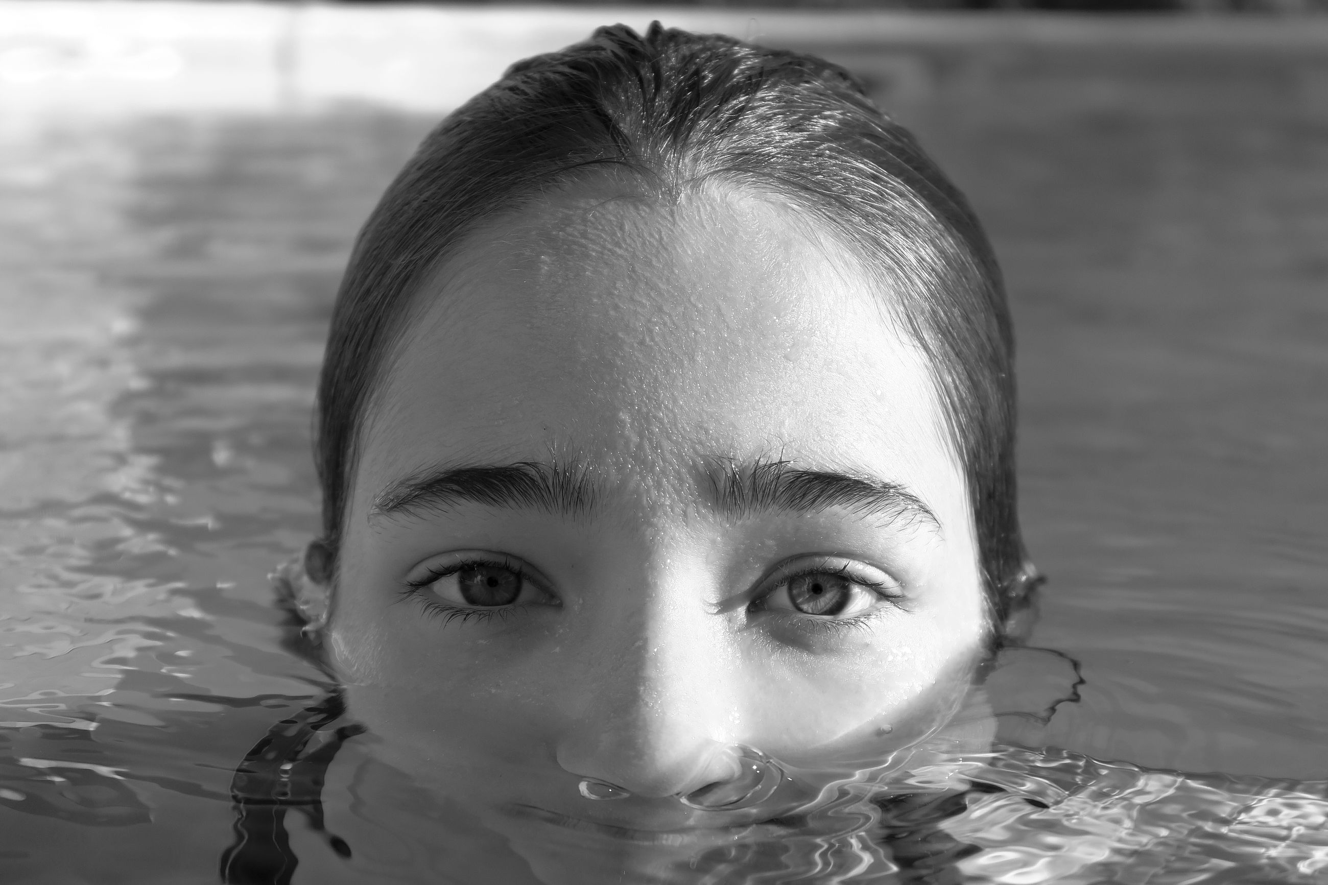 water, portrait, looking at camera, childhood, front view, one person, headshot, swimming pool, close-up, human face, real people, outdoors, swimming, day, young adult, people