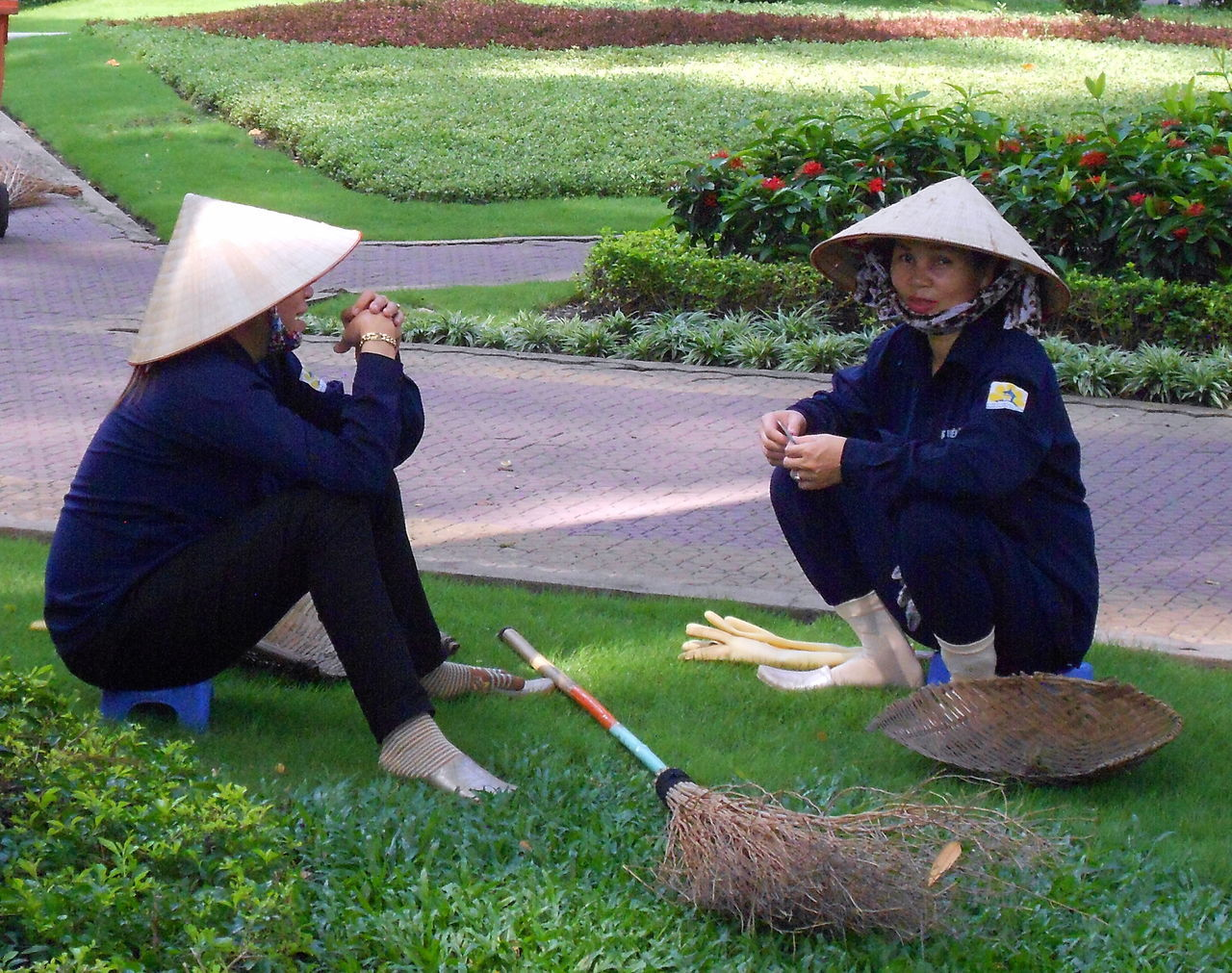 Adult Brush Clear Sky Grass Ho Chi Min City Non La Outdoors People Real People Rest Resting Saigon, Vietnam Sitting Togetherness Two People Two Women Vietnam Travel Vietnam Trip Vietnamese Conical Hat Women Working