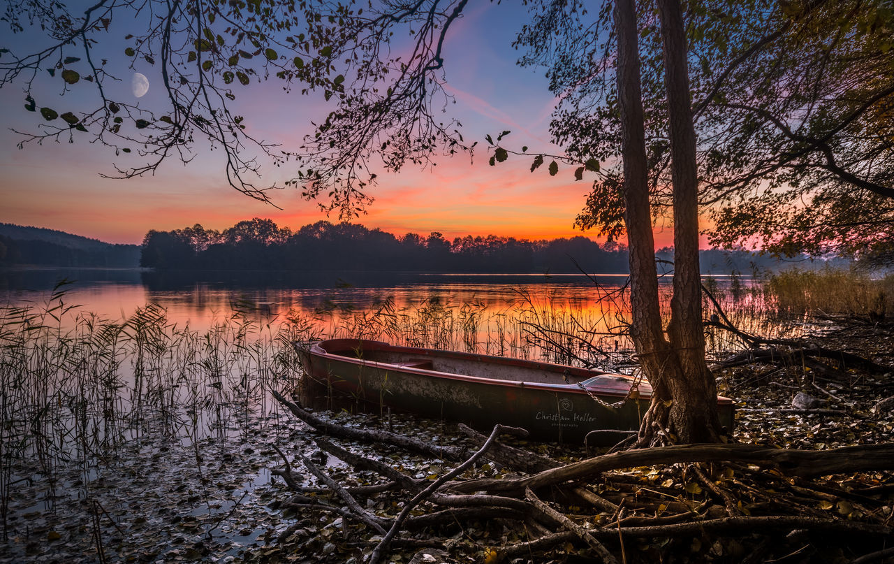 Festgemacht! Beauty In Nature Boat Branch Calm Chorin Cloud - Sky Growth Lake Nature Nautical Vessel No People Non-urban Scene Orange Color Outdoors Red Scenics Sky Solitude Sunset Tranquil Scene Tranquility Transportation Tree Water Waterfront