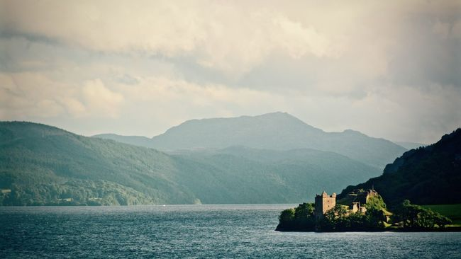 Urquhart Castle and Loch Ness, Scotland Beauty In Nature Castle Cloud Cloud - Sky Idyllic Loch Ness Majestic Mountain Mountain Range Nature No People Outdoors Scenics Scotland Sky Tranquil Scene Tranquility UrquhartCastle Water Waterfront