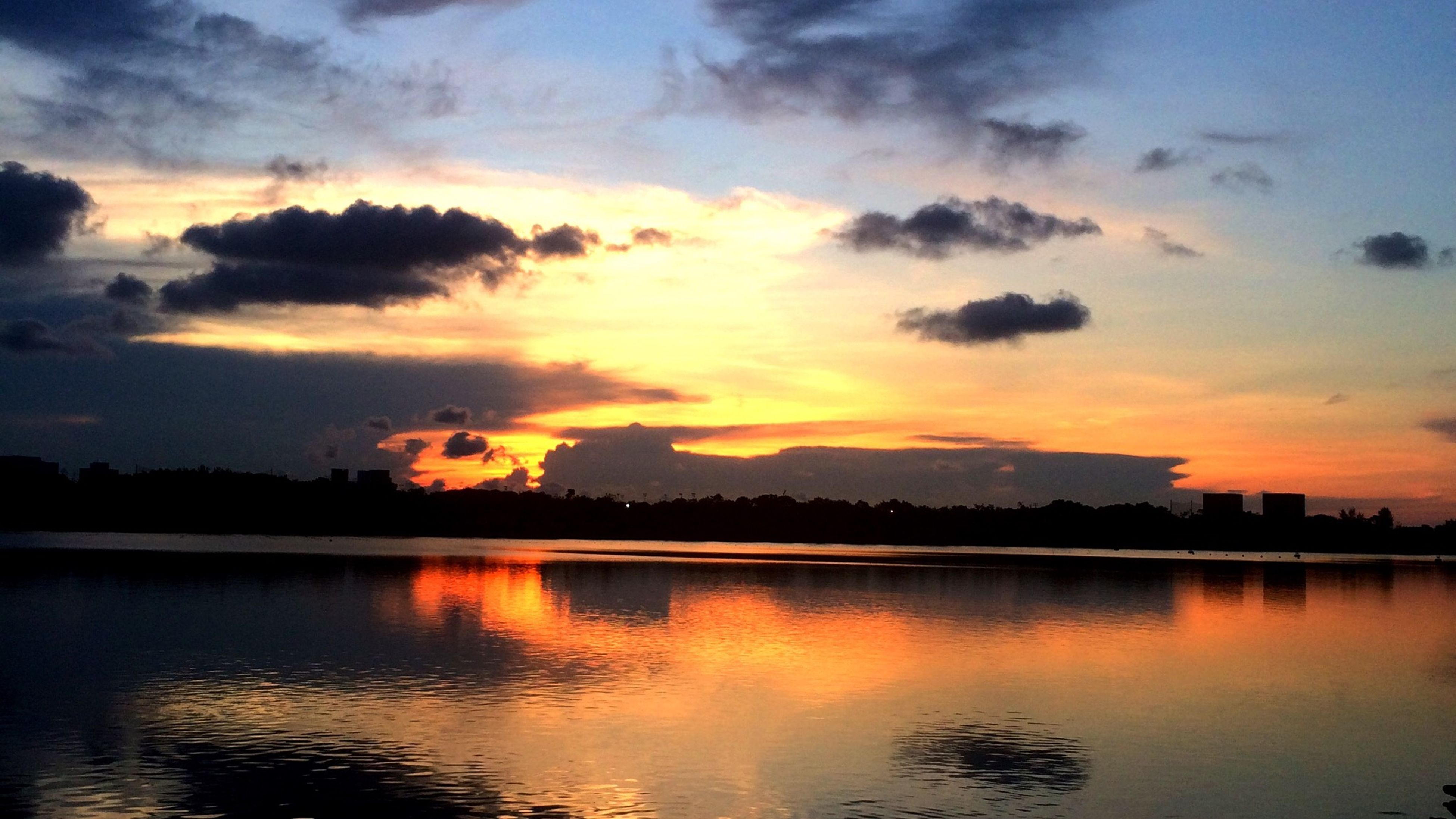 sunset, water, sky, reflection, scenics, tranquil scene, lake, waterfront, tranquility, beauty in nature, orange color, cloud - sky, silhouette, idyllic, nature, cloud, river, dramatic sky, outdoors, mountain