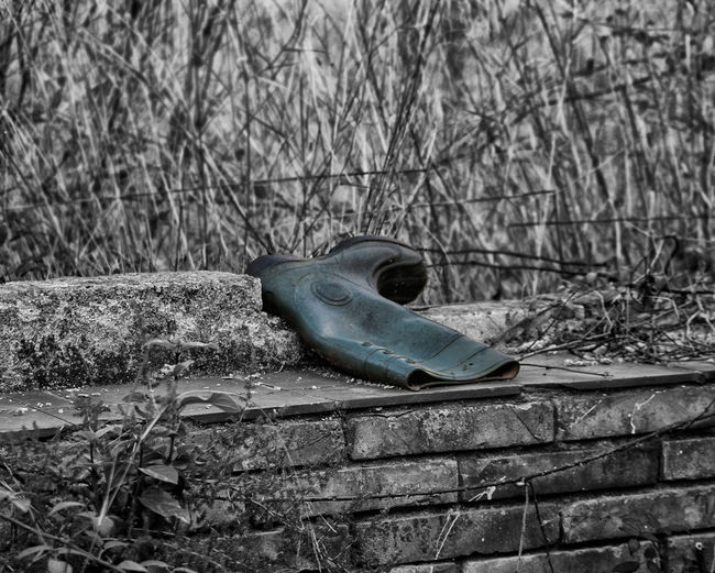 Selective colour photo of an old Wellie on an old brick wall in the middle of a forest. Abandoned Blackandwhite Monochrome Obsolete Old Outdoors Selective Color Selectivecolor Single Object The Past Tranquil Scene Wellies  Wellington Boots