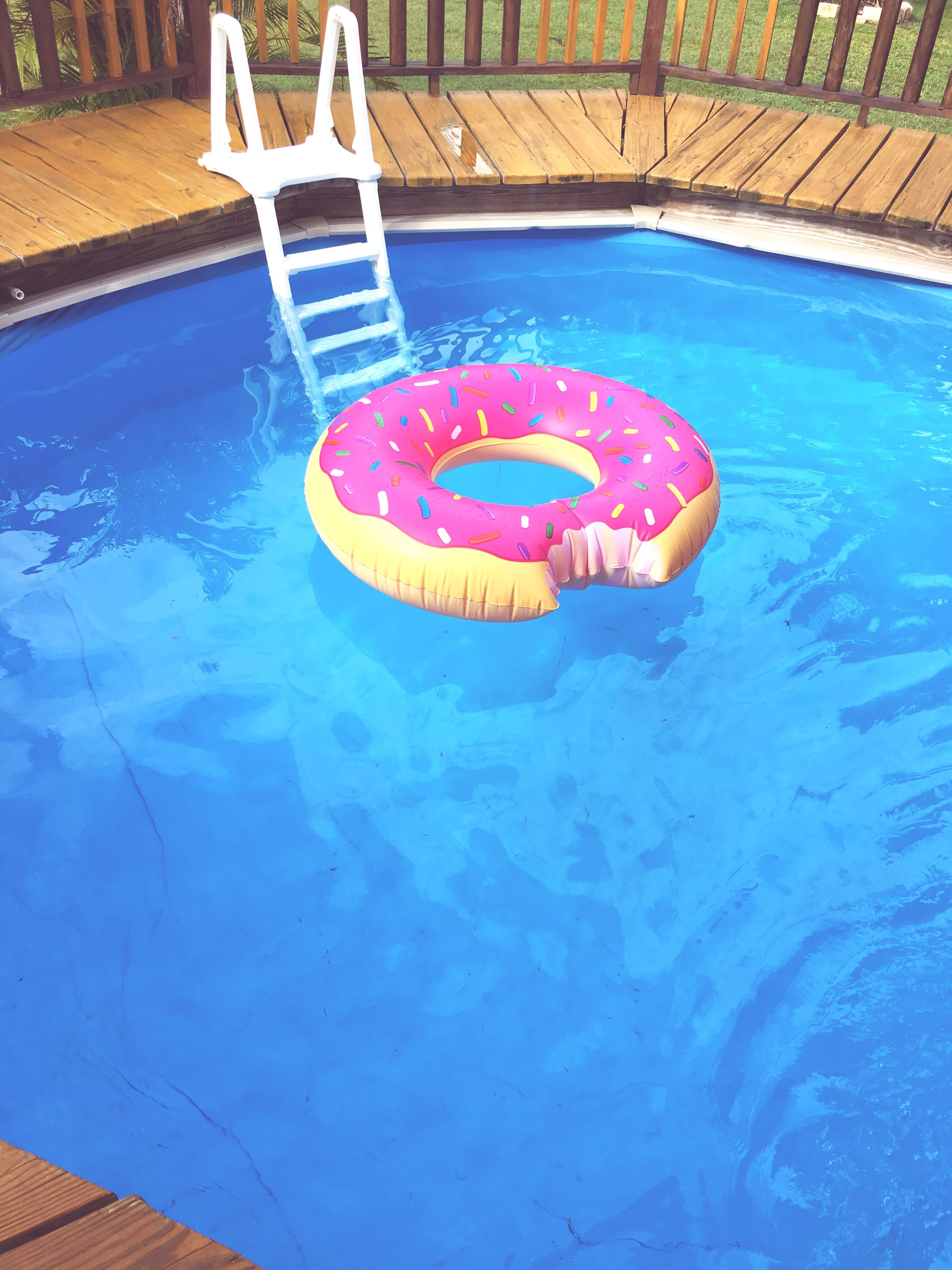 water, swimming pool, inflatable, inflatable ring, floating on water, pool raft, blue, waterfront, day, high angle view, sunlight, no people, outdoors, vacations, swimming, nature, close-up