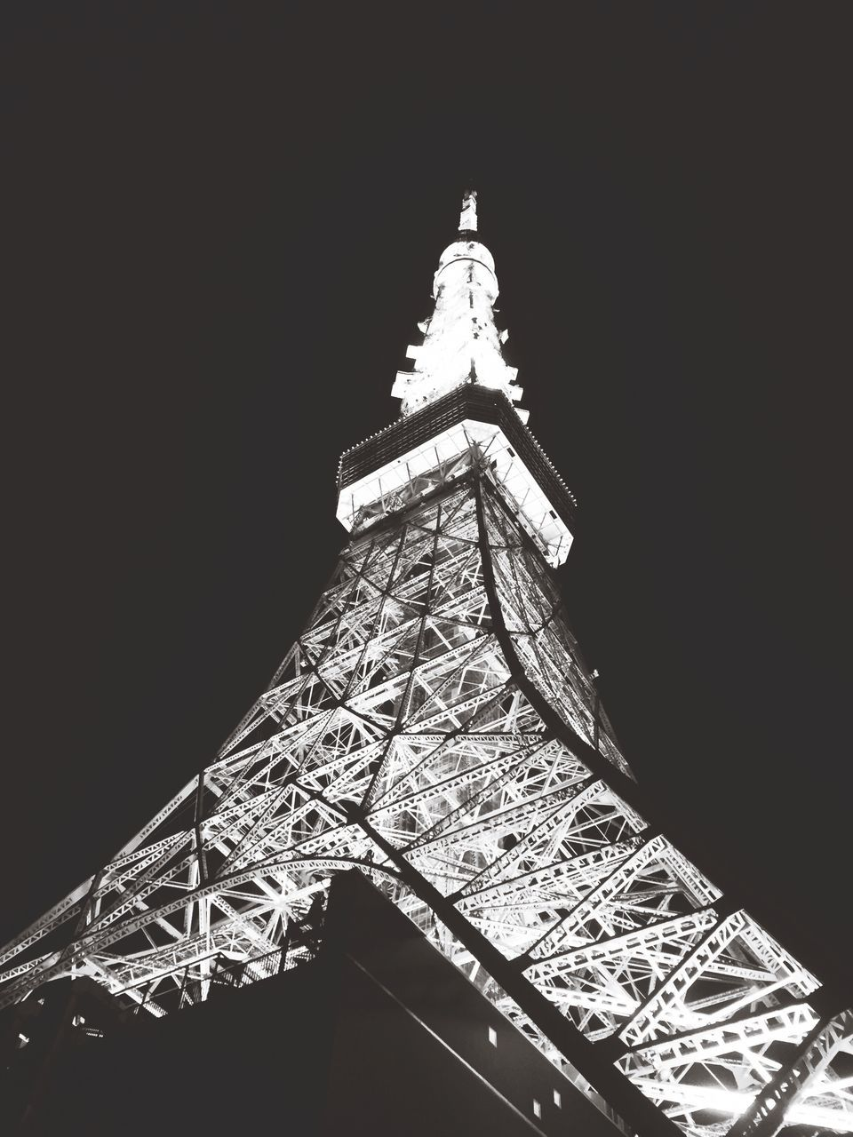 tower, low angle view, architecture, tall - high, built structure, night, illuminated, travel destinations, architectural feature, copy space, tourism, no people, clear sky, celebration, history, outdoors, building exterior, sky