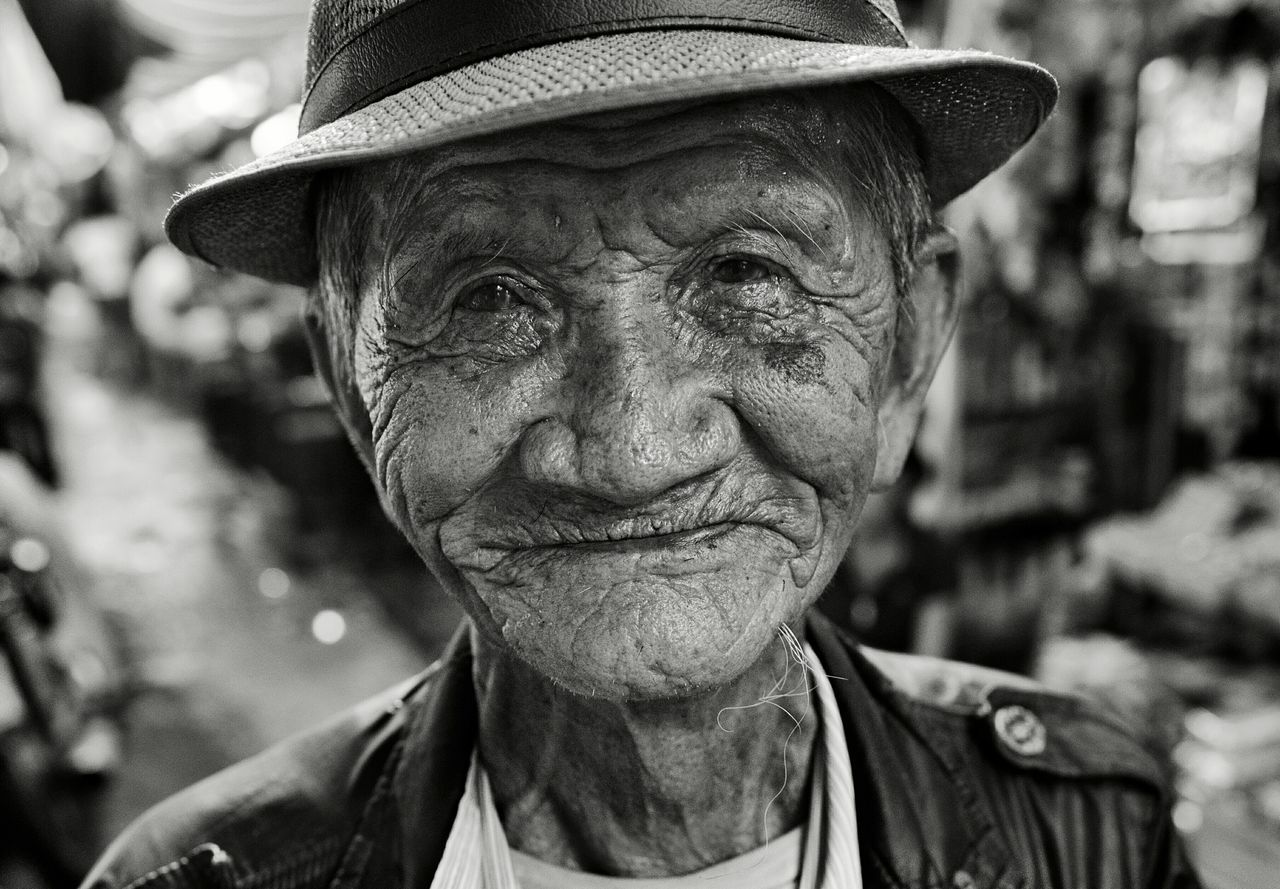 senior adult, senior men, wrinkled, one senior man only, portrait, hat, real people, looking at camera, one person, human face, outdoors, headshot, focus on foreground, men, day, lifestyles, wisdom, close-up, one man only, adult, people
