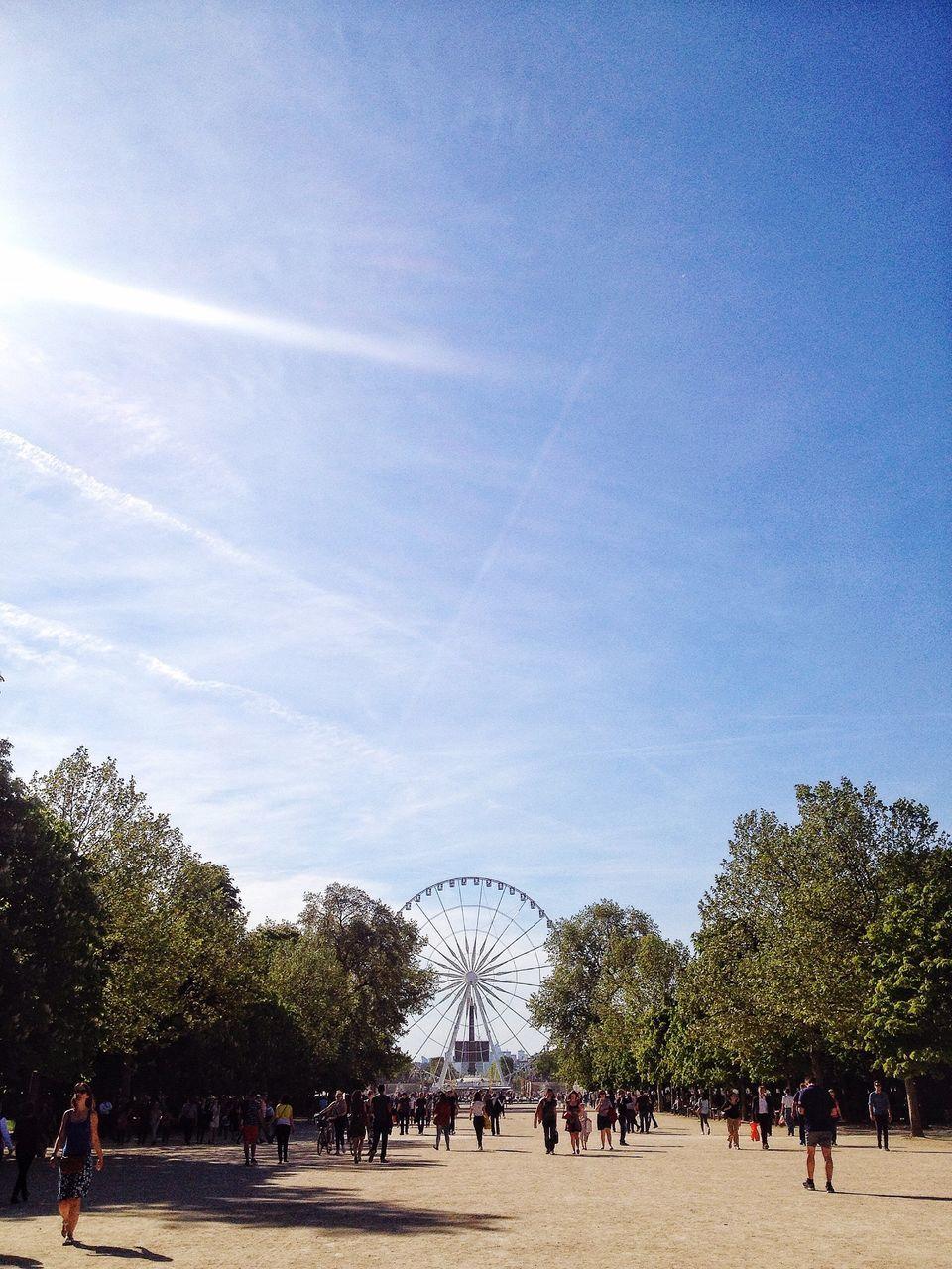 People At Jardin Des Tuileries Against Sky