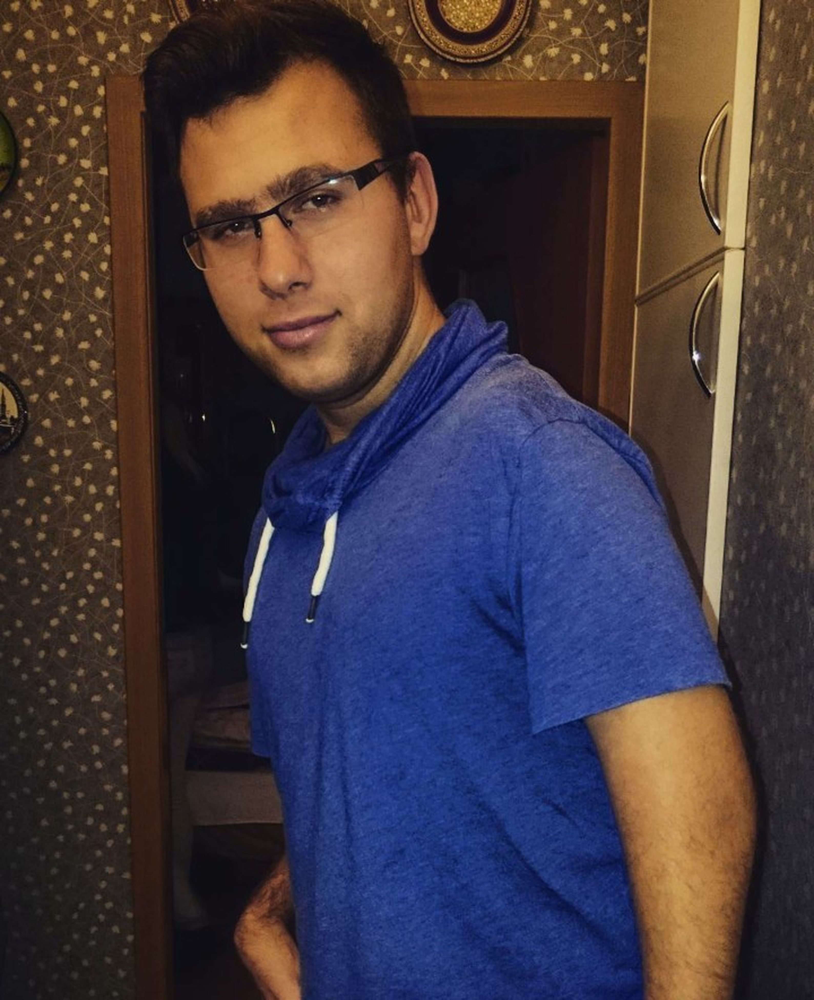 young adult, looking at camera, portrait, person, casual clothing, front view, indoors, lifestyles, young men, leisure activity, waist up, smiling, standing, three quarter length, eyeglasses, handsome