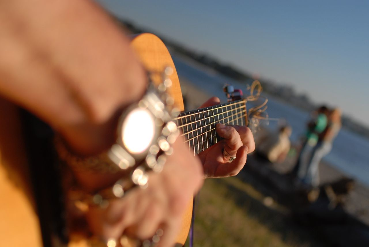 TakeoverMusic Music Musical Instrument Human Hand Real People Guitar Playing Outdoors Busker Beach Braceletsformen Tattoo TakeoverMusic