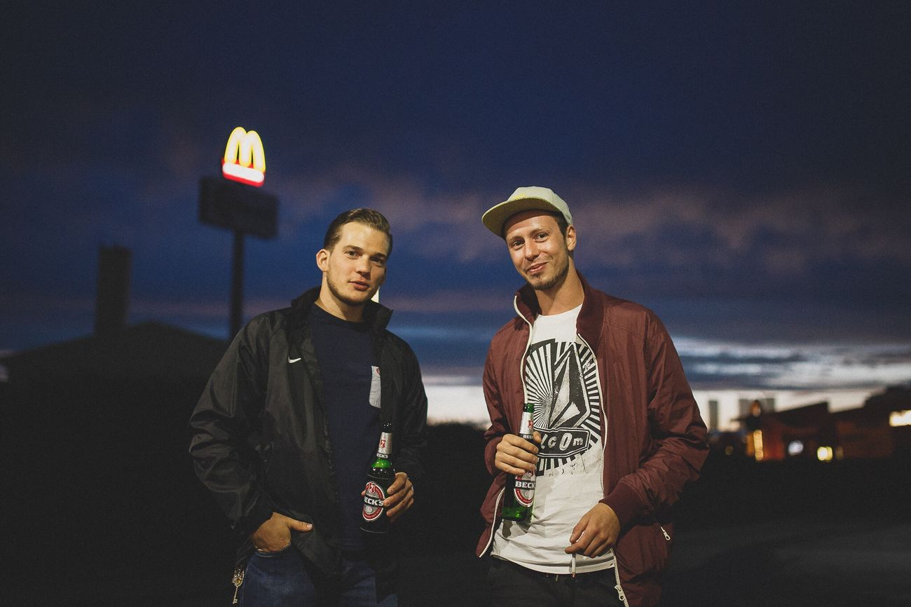 Cheers, Homie Portrait Two People Only Men Friendship Confidence  Looking At Camera People Outdoors Baseball Cap Young Adult Available Light Night Ezuml Sky Standing Dawn City Feel The Journey Portrait Photography Focus On Foreground The Portraitist - 2016 EyeEm Awards