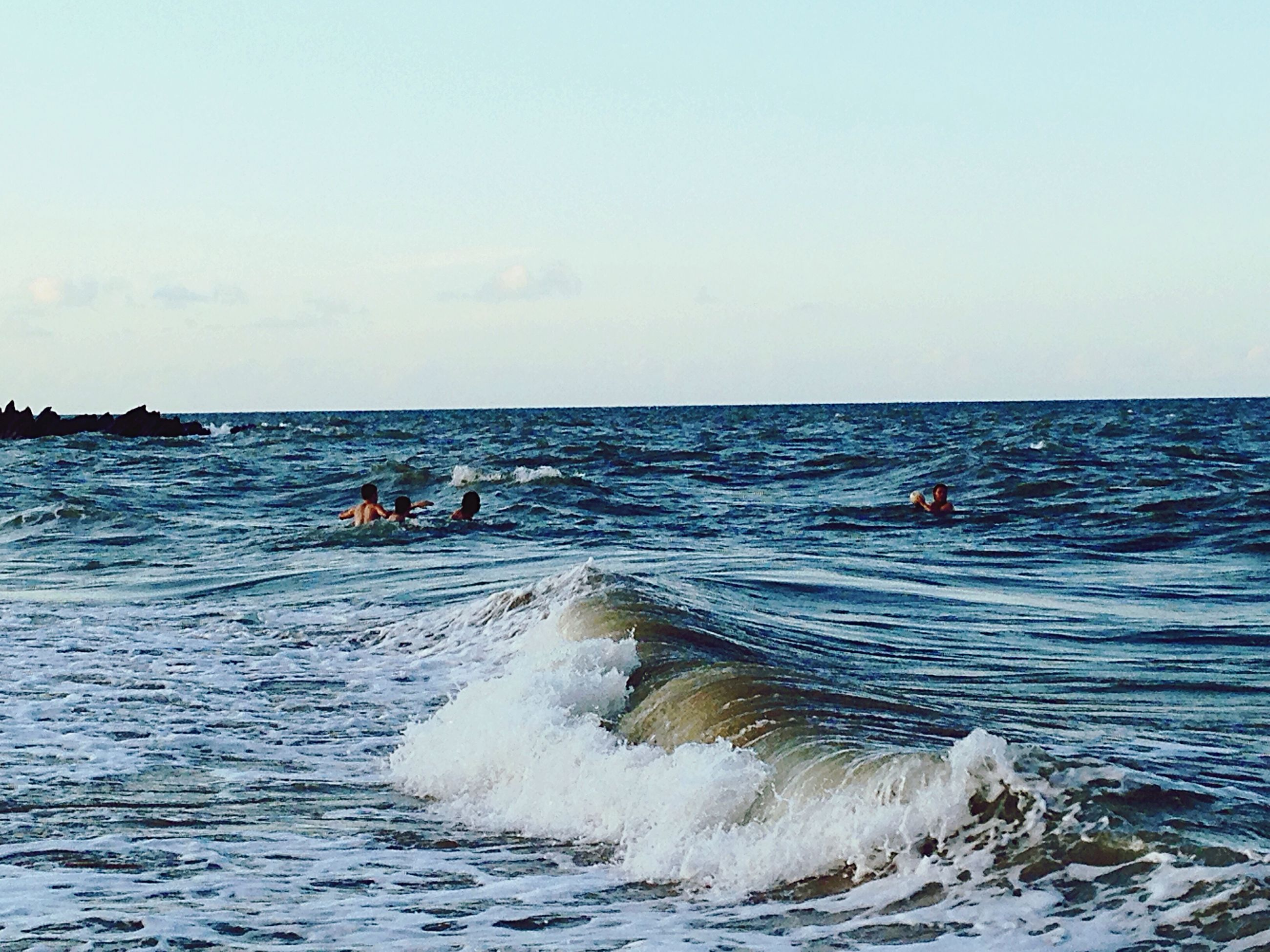 sea, water, horizon over water, vacations, wave, rippled, leisure activity, waterfront, tranquility, scenics, enjoyment, summer, tranquil scene, nature, beauty in nature, fun, seascape, tourist, blue, calm, day, sky, non-urban scene, adventure, outdoors, tourism, weekend activities