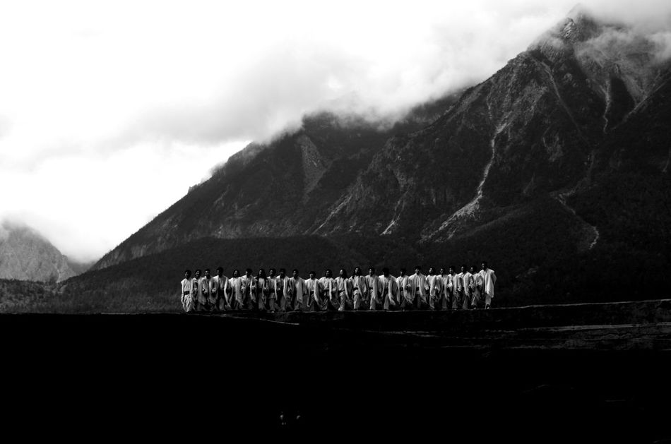 """""""Gather up"""" Moments of the """"Impression Lijiang"""" show, directed by Zhang Yimou. B&w Photography Beauty In Nature Black And White Landscape Men Mountain Mountain Peak Nature Outdoors Sky Traditional Costumes"""