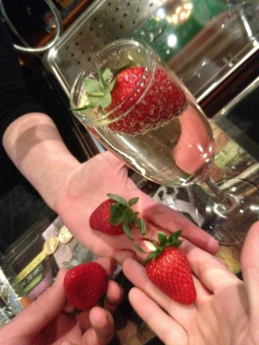 alcholic beverage, champagane with strawberrys champagne glass hands holding strawberrys. Alcohol Drink Holding Drinking Glass Bar - Drink Establishment Refreshment Freshness Champagne Strawberrys Hand Holding Strawberries