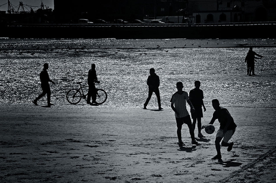 Football Fever Blackandwhite Photography Creative Light And Shadow Beachphotography Sun Reflection On Water Football Game By The Sea On The Sand Football Field Footballislife Black&white People Playing Football Football Is Here Football Is Everywhere Light And Shadow Football Time  Blackandwhite Beach Life Sport In The City Sports Photography Football The Journey Is The Destination - Essaouira Morocco