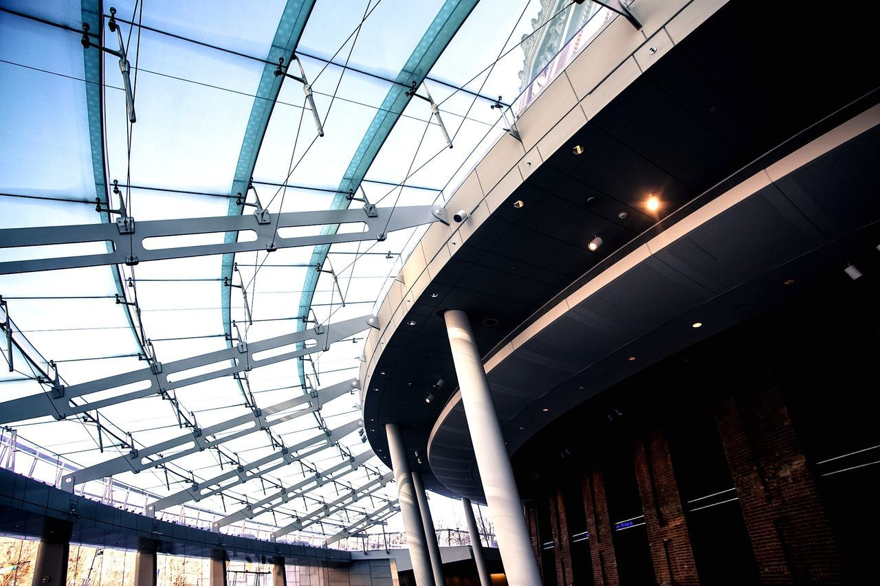 low angle view, architecture, built structure, ceiling, illuminated, no people, indoors, day, modern, building exterior, sky