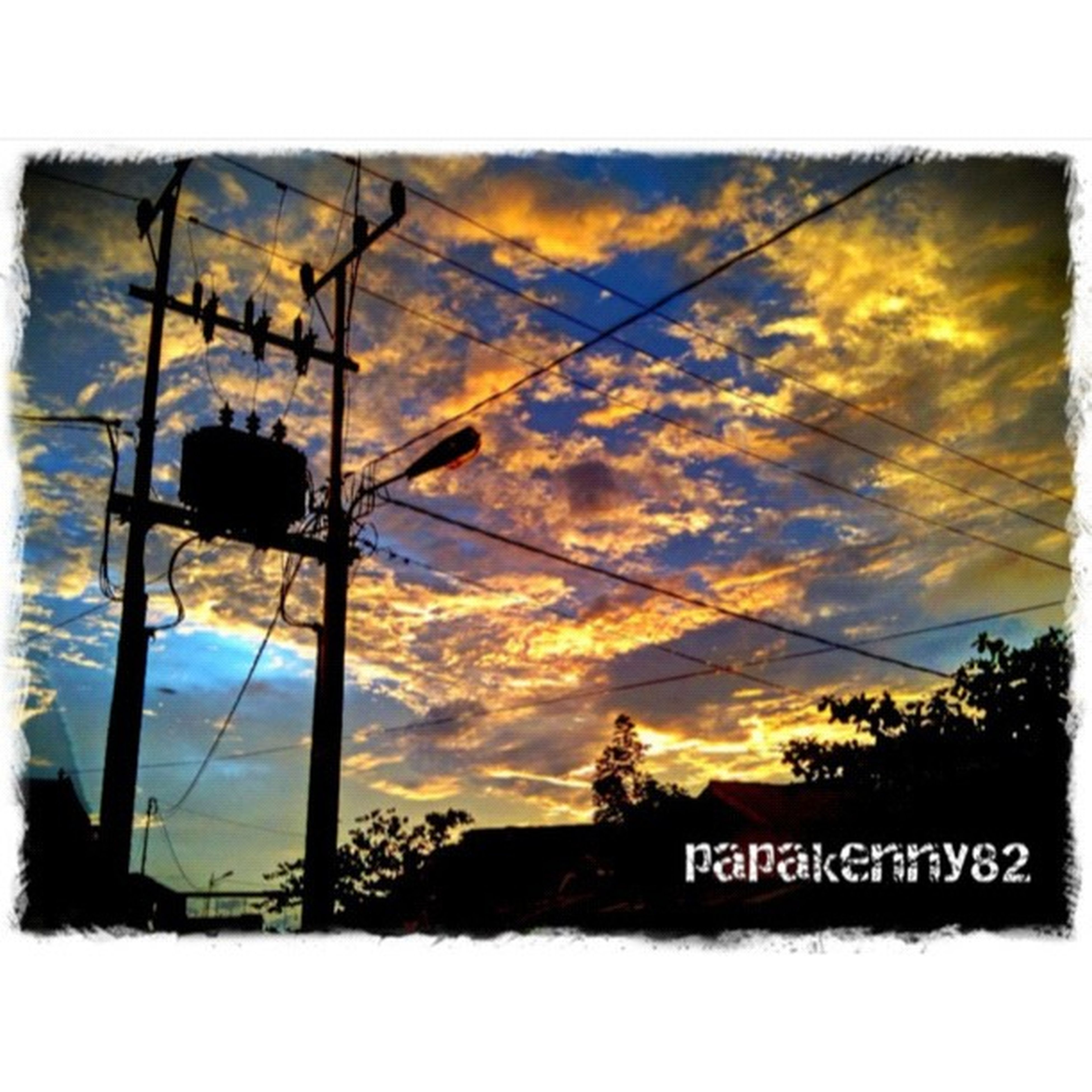 transfer print, sky, auto post production filter, power line, electricity pylon, sunset, communication, power supply, low angle view, cloud - sky, electricity, text, cloud, western script, tree, nature, outdoors, cloudy, cable, no people
