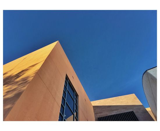 UNLV EyeEm Best Shots This Week On Eyeem Minimalist Architecture Minimalobsession Minimalism Architecture Built Structure Building Exterior Low Angle View Modern Travel Destinations Clear Sky Day Outdoors No People Blue Sky City