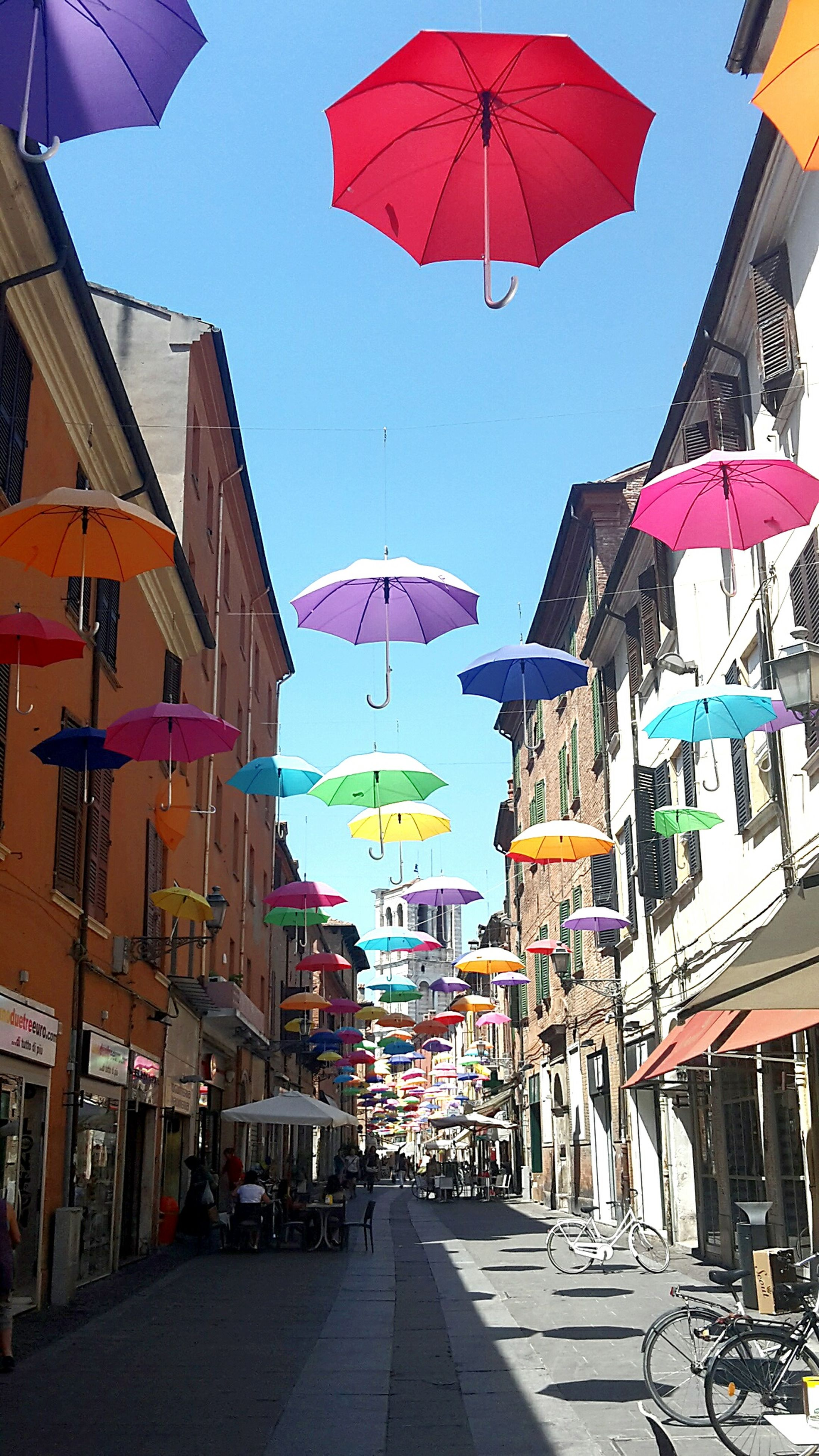 architecture, built structure, multi colored, city, parasol, in a row, sky, day, colorful, outdoors, city life, abundance, blue, arrangement