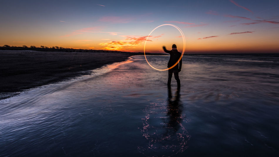 Fire and light between land and sea 16x9 Beauty In Nature Copy Space Dark Evening Horizon Over Water Landscape Light Long Exposure Nature Netherlands Night No People Outdoors Scenics Sea Self Portrait Silhouette Sky Sunset Tranquility Water Zeeland  Lost In The Landscape Love Yourself