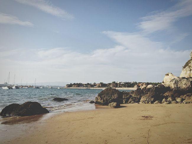 Beach Sunshine Relaxing Enjoying The Sun Sky And Clouds Boats Cliffs Rocks Sea