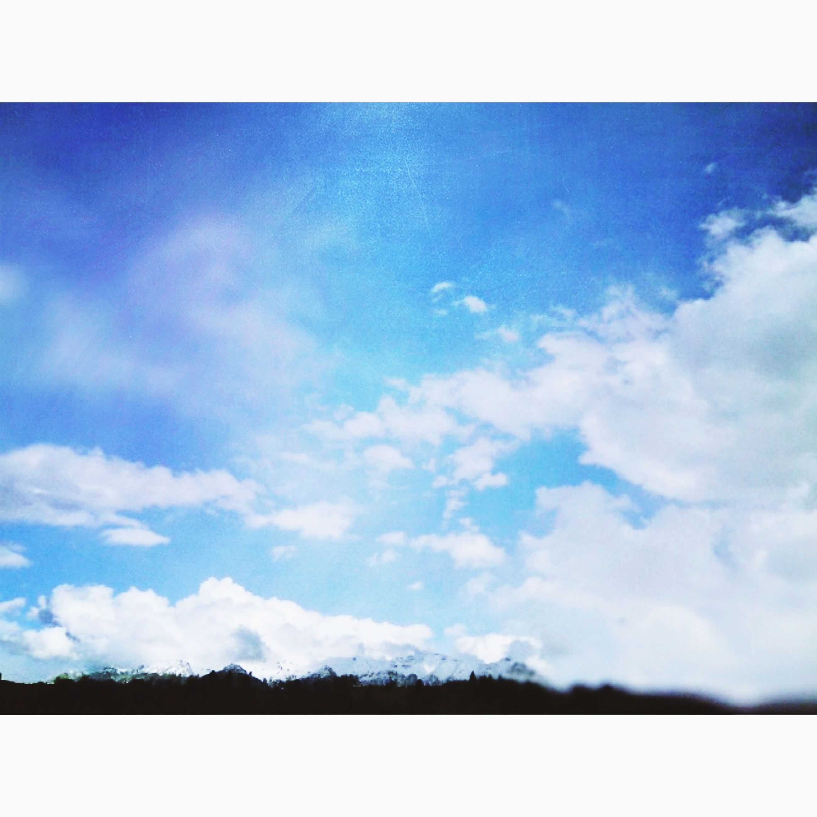 transfer print, auto post production filter, sky, cloud - sky, tranquility, tranquil scene, beauty in nature, scenics, nature, cloud, blue, low angle view, cloudy, outdoors, day, no people, idyllic, cloudscape, copy space, non urban scene