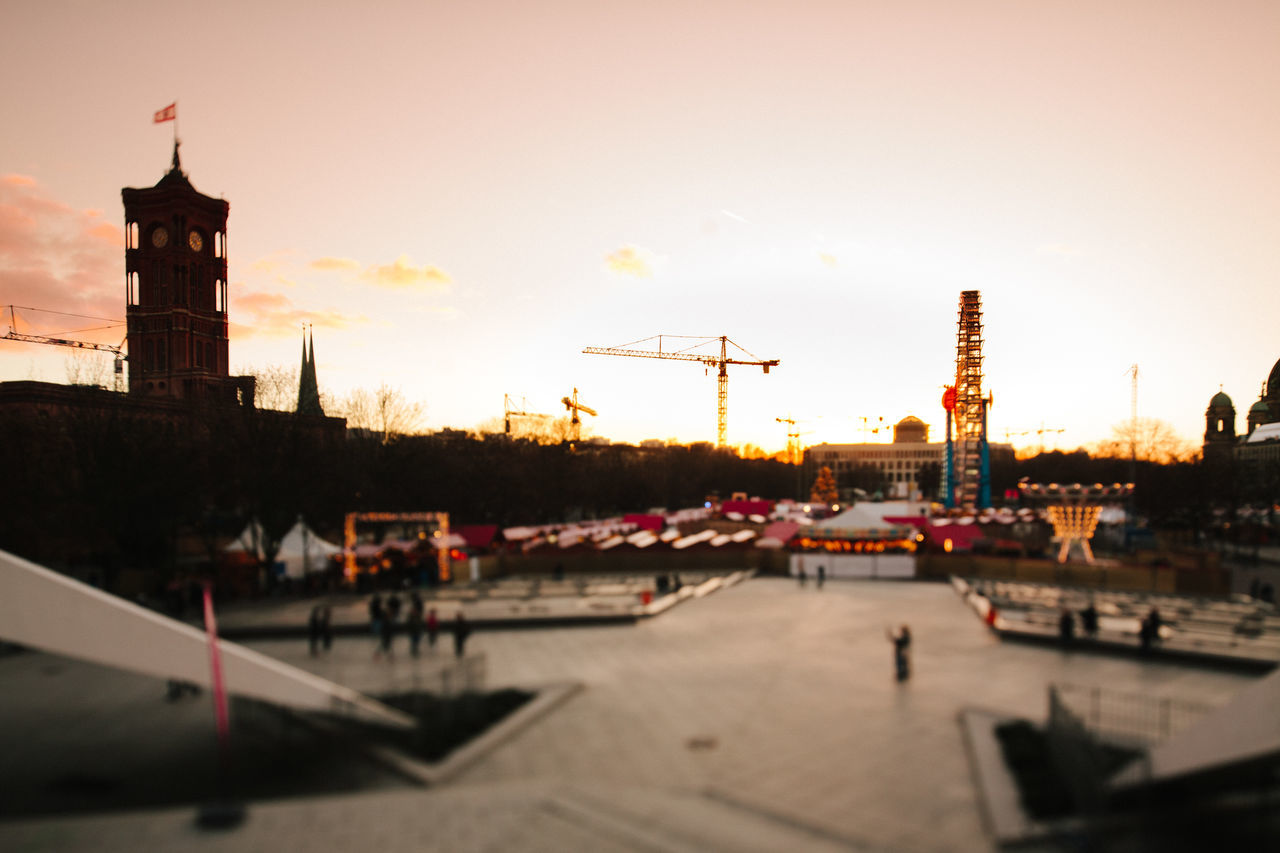 Colorful evening in winter in downtown Berlin Alexanderplatz Annual Fair Architecture Building Exterior Built Structure Christmas Fair Christmas Market City City Hall Colorful Evening Ferris Wheel Late No People Outdoors Red Rotes Rathaus Selective Focus Sky Sunset Winter