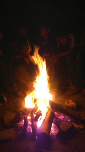 A bonfire and some scary stories,an awesome way to start the new year Happy New Year 2015 Hanging Out People Fire Light And Shadow