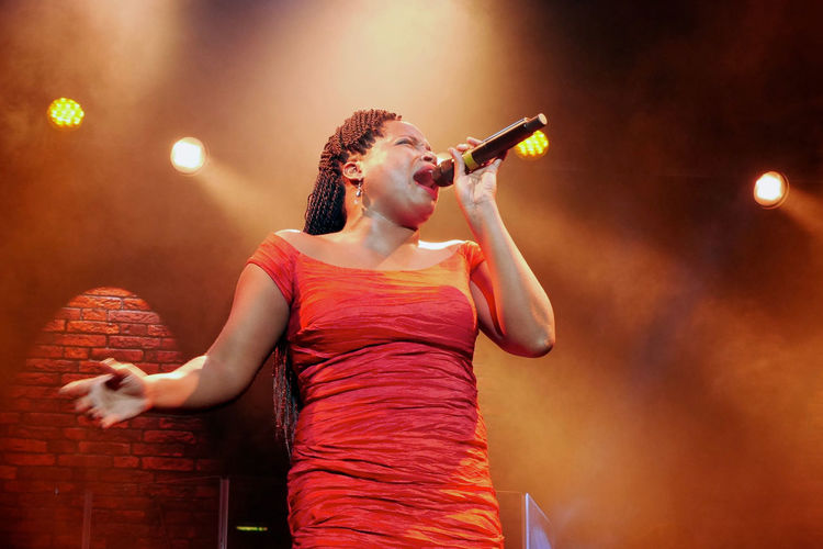 Equoia Coleman Blues Singer Microphone Music Musical Performance Musical Photos Nightlife On Stage One Person Performance R&b R&b Music Red Dress Singer  Singer  Singer And Artist Singing Stage Lights Stage Photography Stage Show TakeoverMusic Business Stories
