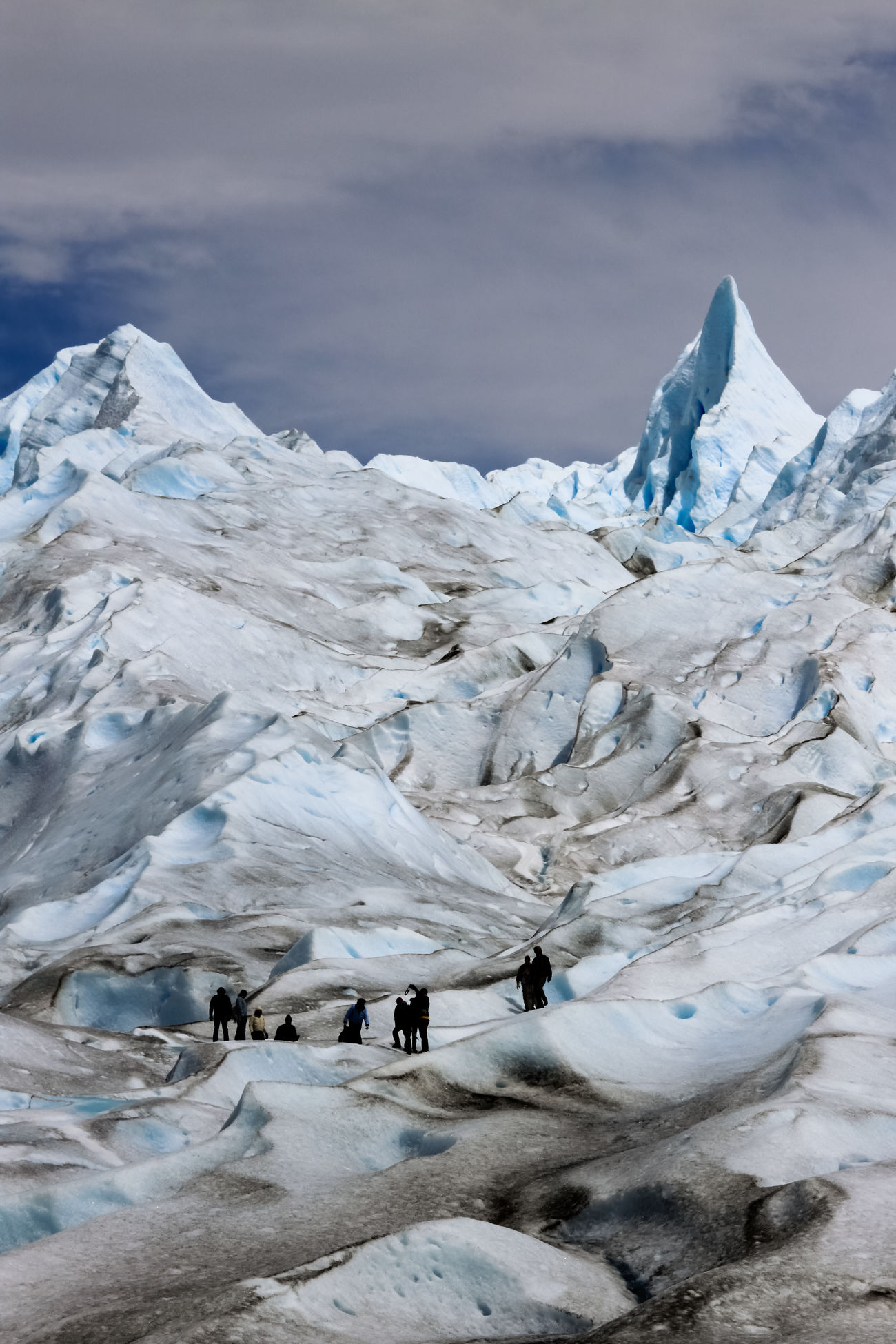 Ice climbing on the Perito Moreno Glacier. The glacier consists of over 250 km2 (97 sq mi) of ice spanning 30 km (19 mi) in length and a width of 5km at its terminus. One of 48 glaciers that form part of the Southern Patagonian Ice Field, the high altitude ice field has a total area of 12,363 km2 (4,773 sq mi) of ice. Los Glaciares National Park, Santa Cruz , Argentinean Patagonia, Argentina. Love Life, Love Photography America Argentina Beauty In Nature Blue Cliff Climbing Cold Temperature People Glacier Ice Landscape Moreno Mountain Nature Outdoors Patagonia Perito Moreno. Patagonia. Argentina. Sky Snow Southern IceField Glaciers Glacier Surreal Fractured