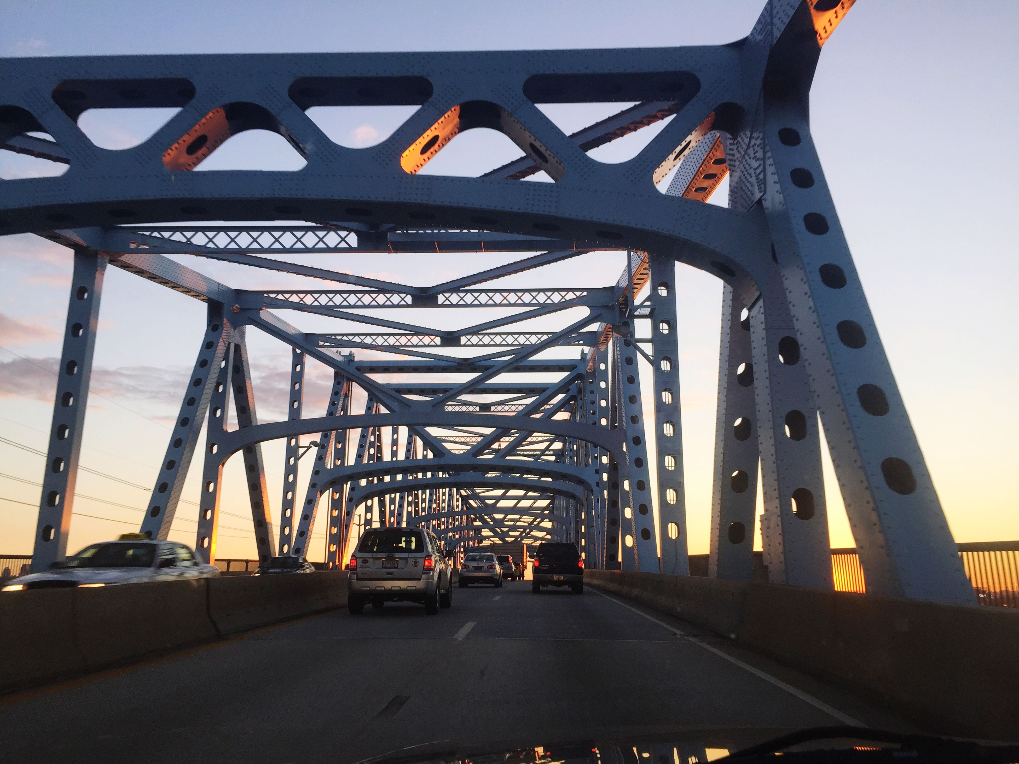 transportation, bridge - man made structure, connection, car, land vehicle, engineering, built structure, mode of transport, the way forward, road, architecture, bridge, sky, diminishing perspective, road marking, travel, clear sky, street, metal, vanishing point