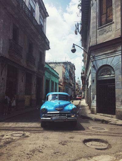 Typical street scene including a car in Old Havana/Cuba Architecture Car Building Exterior Built Structure Transportation Street City Mode Of Transport Land Vehicle Sky Day No People Outdoors Oldtimer Cuba Havanna, Cuba Live For The Story