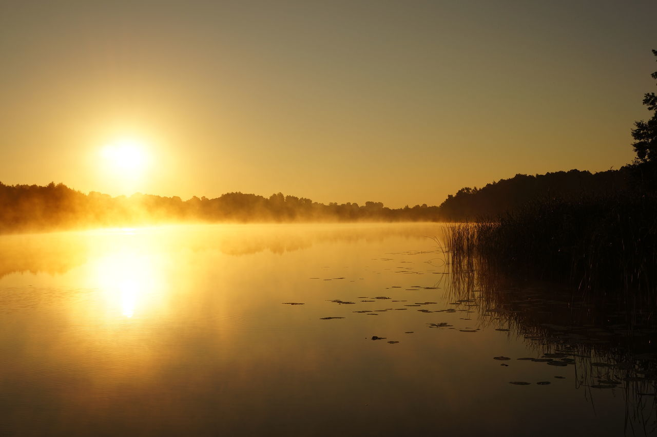 Scenic View Of Lake Against Sky During Sunrise