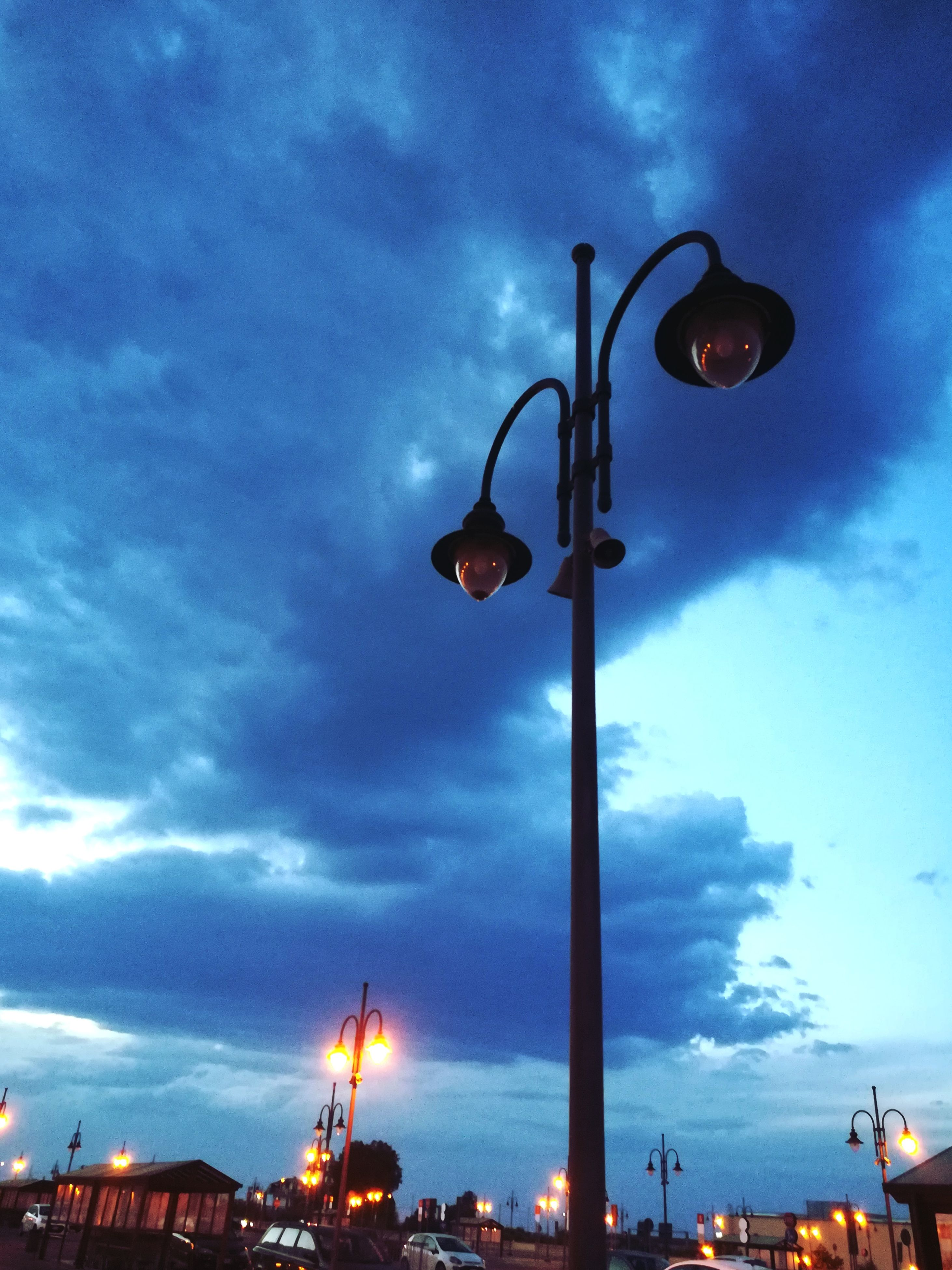 cloud - sky, sky, low angle view, street light, architecture, built structure, illuminated, no people, outdoors, building exterior, day, nature
