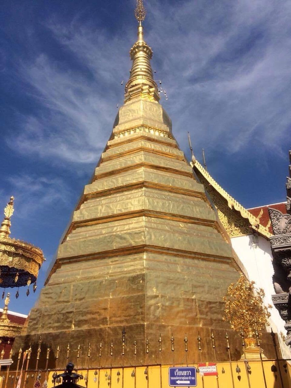 religion, spirituality, architecture, pagoda, place of worship, built structure, gold colored, building exterior, sky, low angle view, gold, travel destinations, no people, outdoors, day