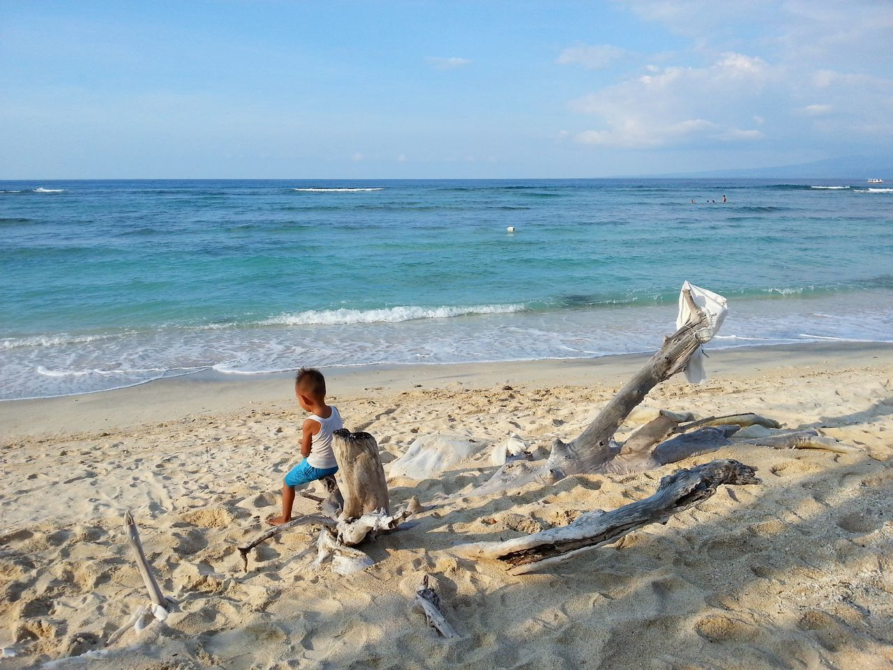 Kid thinks about his future on a beach in Gili Trawangan Island, Indonesia. Travel Photography Remote Places Beachlife Islandlife Amazing_captures Seascape Travel Forsale Stockphoto Tripofwonders Wonderfulindonesia Photography Beachphotography Photos