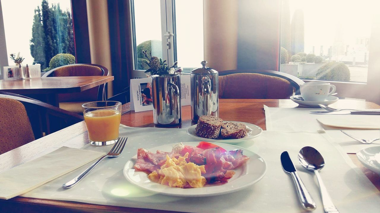food and drink, table, plate, food, breakfast, indoors, restaurant, drink, coffee - drink, refreshment, day, serving size, no people, freshness, fork, sunlight, ready-to-eat, drinking glass, place setting, healthy eating