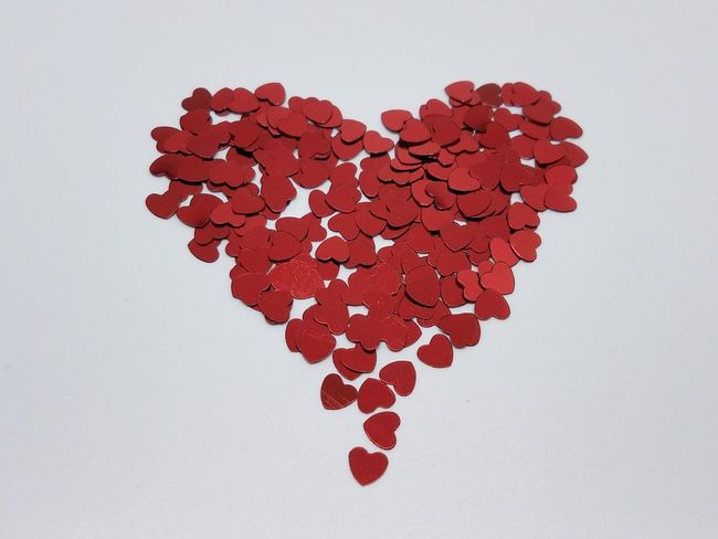 """Love"" sign built with red confettis Love Confettis Red Valentine's Day  Romantic Wedding Decoration EyeEm Selects Shape Relationship Difficulties Close-up Valentine Card"